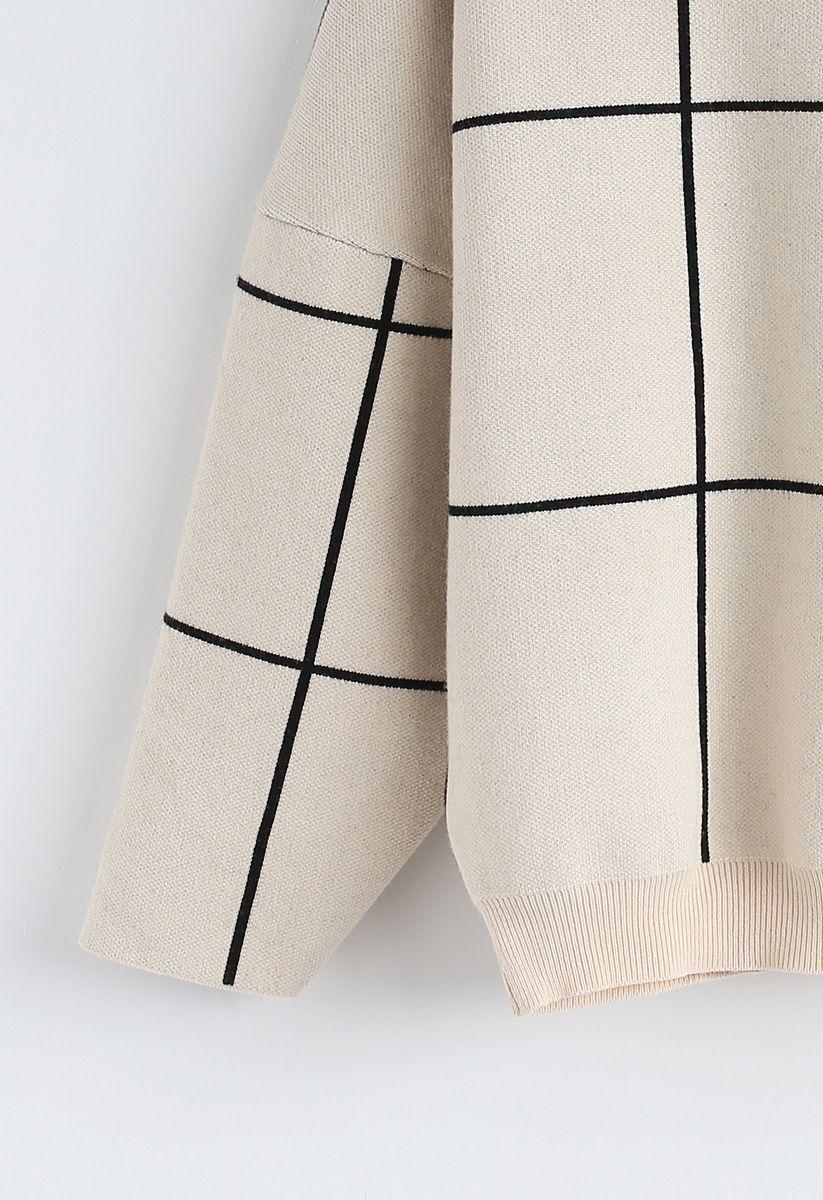 Suéter Blanco con Cuello Tortuga y Estampado de Cuadrícula