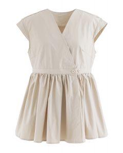 Cotton Sleeveless Wrapped Peplum Top in Light Tan