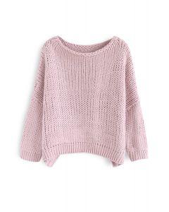 El otro lado del grueso suéter tejido a mano en rosa
