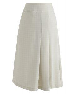 Favorezca la falda midi plisada femenina en crema