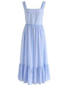Vestido camisero de rayas azules con sentido veraniego